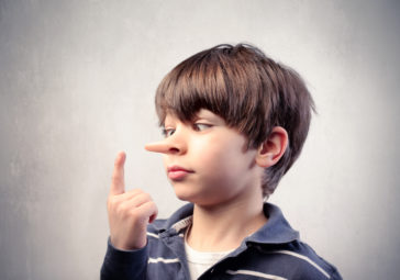 Image of a boy with lying 'Pinochio' nose