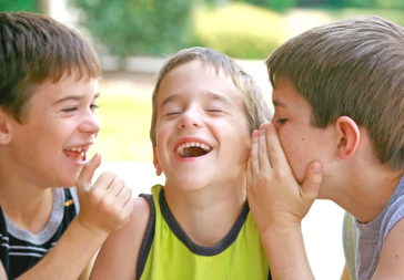 Image of three boys telling jokes