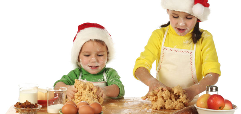 Image of Little children cooking the Christmas cake